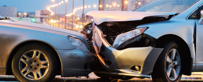 automobile crash accident. Car collision on city street. Two damaged vehicles